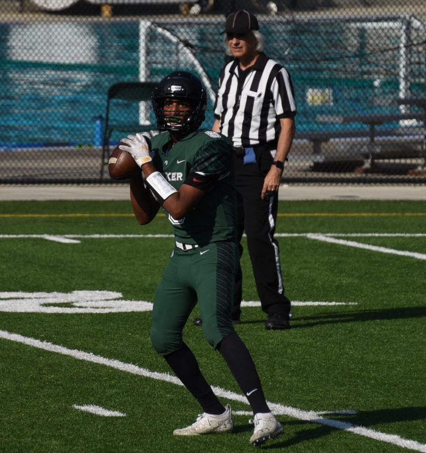 Quarterback Rohan Gorti (11) drops back to throw the football.