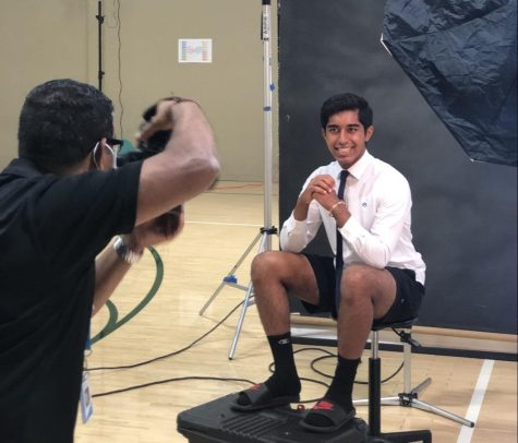 Kaden Kapadia (12)  poses in a dress shirt and tie. Students could select additional outfits based on the photo package they chose.