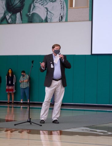 Dean of Students Kevin  Williamson addresses the student body on the Community Expectations on dress during the school meeting on Monday.