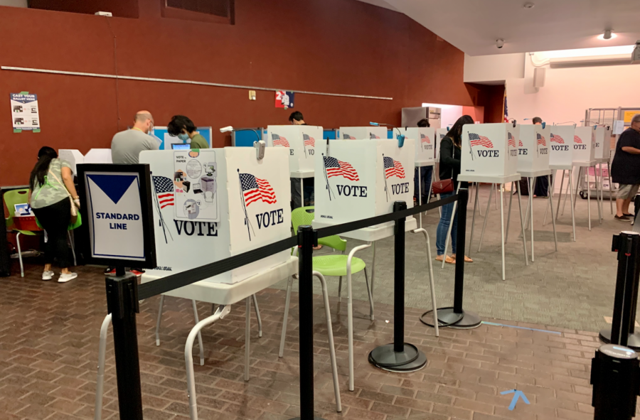 A polling center in the West Valley Branch San Jose Public Library yesterday. Polls closed at 8 p.m. in California.
