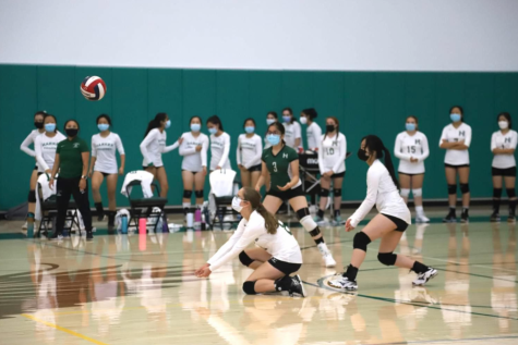 Sophomore Emily McCartney receives a serve during the freshman and sophomore girls volleyball teams match against Notre Dame-Belmont yesterday. The girls lost 12-25, 18-25.