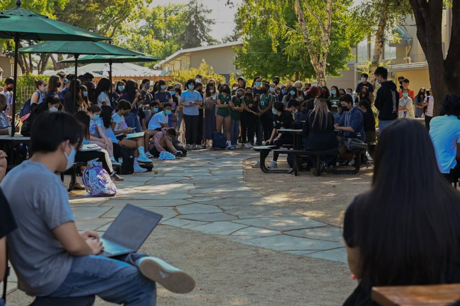 Students and faculty gather in a circle around the Quad on Thursday during the town hall. Students brought up various points, including concerns about not allowing athletic shorts and enforcing the fingertip length rule.