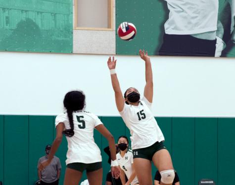Rachel Ning (11) sets opposite hitter Jessica Tang (11) during the girls varsity volleyball teams match again Santa Cruz High School on Sept. 3.