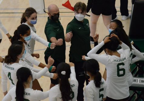 The junior varsity girls volleyball team huddles up between sets during the teams match against Notre-Dame Belmont today. The girls lost 16-25, 16-25.