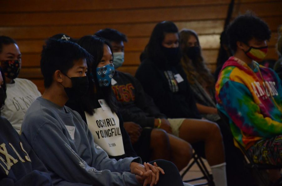 Richard Zhang (11) and Erica Cai (12) listen attentively as a Challenge Day facilitator speaks. Throughout the day, two facilitators from the Challenge Day organization led various activities focused on fostering empathy and finding common ground.