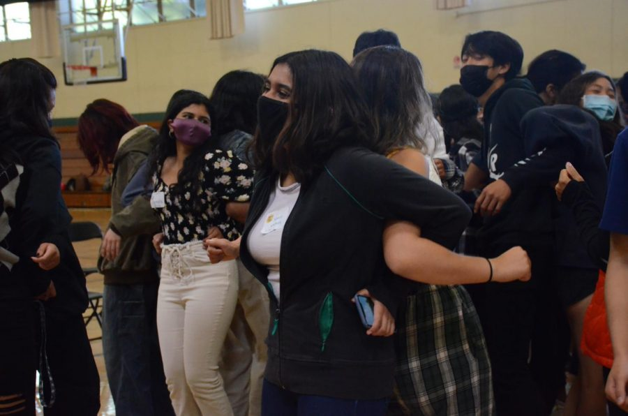 Samvita Gautham (11) dances with a partner during one of the bonding activities. After upper school participants linked arms and danced to music, they turned around and shared their answers to a prompting question introduced by a Challenge Day facilitator.