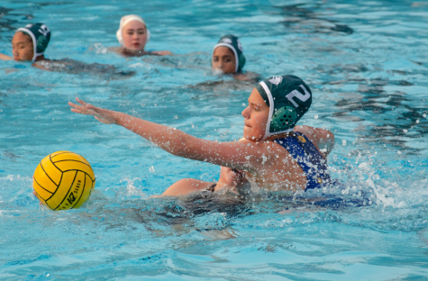 Sydney Adler (11) reaches for the ball during the water polo teams match against Mountain View on Sept. 9.