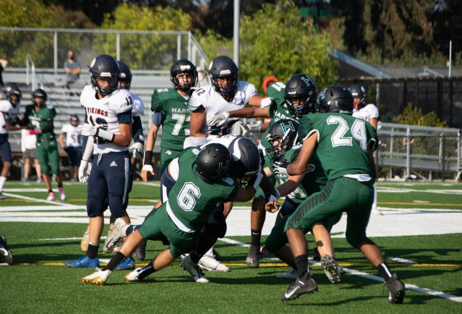Captain Maddux Carlisle (12) tackles a Lynbrook player. The football team has a record of 1-2 in league.