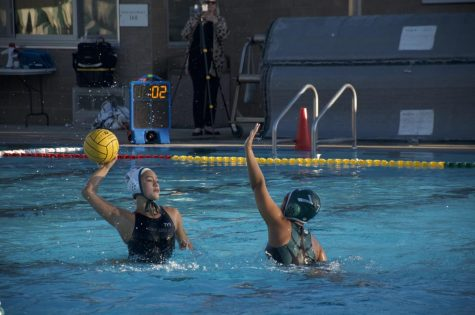 Deeya Kumar (11) attempts to block Palo Alto players pass attempt. The varsity girls water polo team is now ranked fourth in league with a record of 6-6.