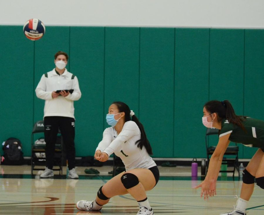Gwen Yang (11) prepares to receive a serve. The junior varsity girls volleyball team will face Notre Dame this Tuesday at 5:00 p.m. for the last match of their season.