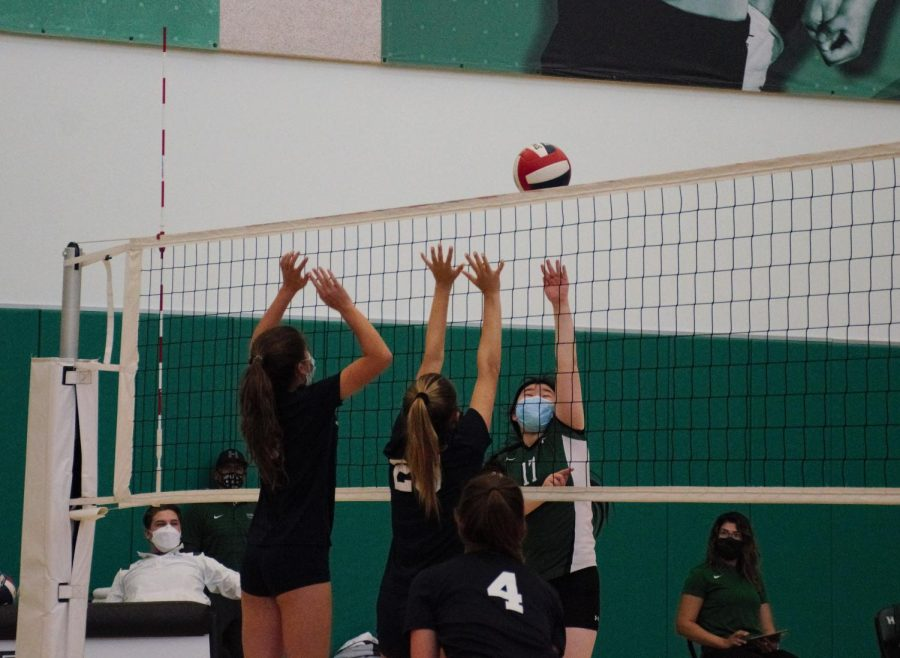 Catherine Wong (10) tips the ball over the net. The freshman and sophomore girls volleyball team will play Mercy High School this Friday at 3:00 p.m. at home.