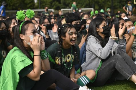 Seniors Yejin Song, Reja Raghib and Melody Yazdi cheer for their class lip sync. The senior class lip sync went last at the spirit rally.