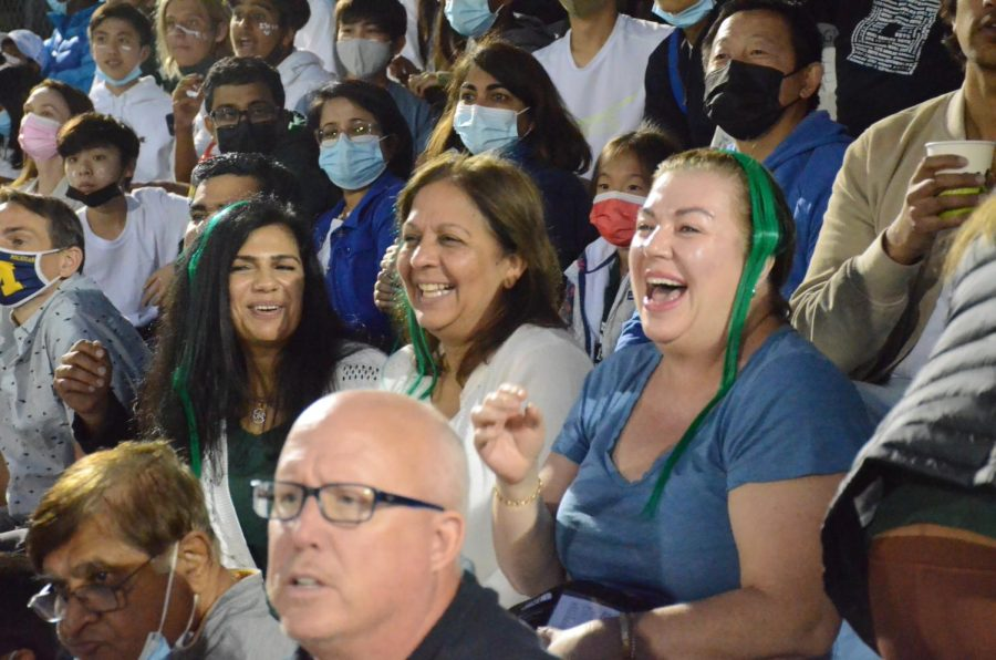 Harker parents cheer for the Eagles.
