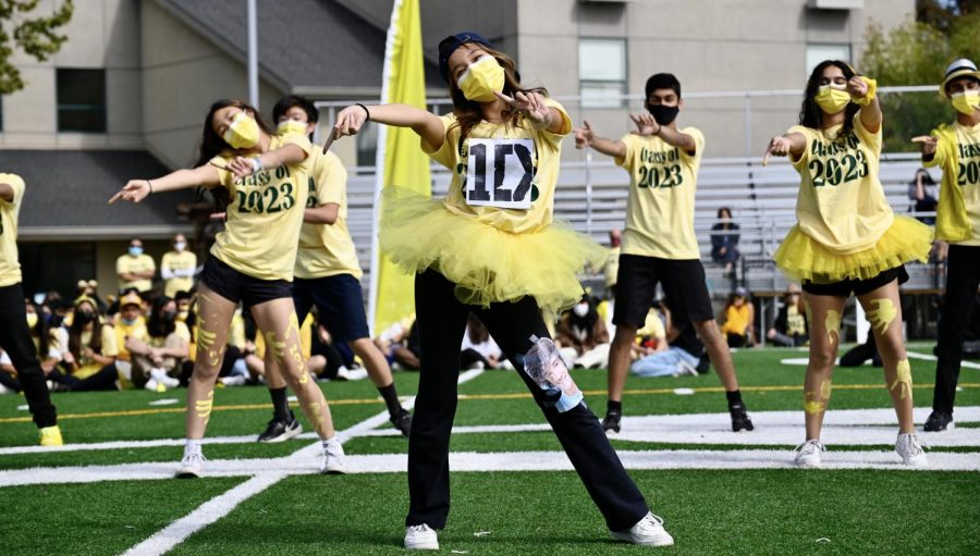 """Eileen Ma (11) dances to One Direction during the junior lip sync, themed new-school music. The one-hour event featured lip sync skits from all four classes, performances by the cheer team and Harker Dance Company (HDC), """"Name that Tune"""" with faculty participants and a relay with Homecoming Court representatives."""