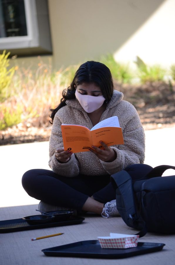 """Namrata Karra (11) looks at a copy of Squad Goals while listening to others read their lines from a scene in """"Squad Goals on Friday. The Student Directed Showcase directors this year are seniors Josh Field, Richard Amarillas, Saumi Mehta and Ysabel Chen."""