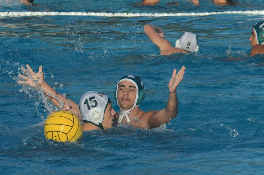 Rajas Apte (9) presses a Leigh player while on defense. The varsity boys water polo team participated in the Silicon Valley Invite Tournament this past weekend.