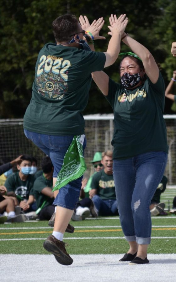 Director of Learning, Innovation and Design Diane Main and Director of Alumni Relations Kristina Alaniz cheer after guessing the right song in the game Name that Tune. Both Main and Alaniz represented the senior class.