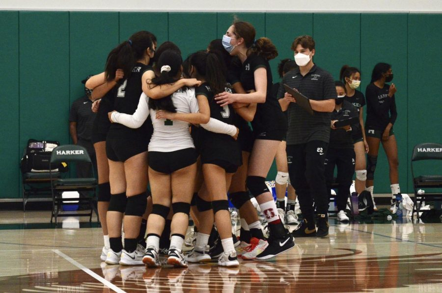 The junior varsity girls volleyball team rejoices in a huddle after their victory against Mercy High School. The Eagles won the match 25-23, 12-25, 15-10.