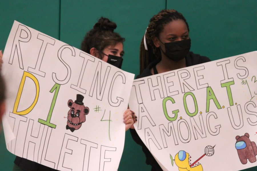 Tara Ozdemir (12) and Brooklyn Cicero (12) hold up signs made for their Senior Night. The team will play at Notre Dame this Tuesday at 6:30 p.m.