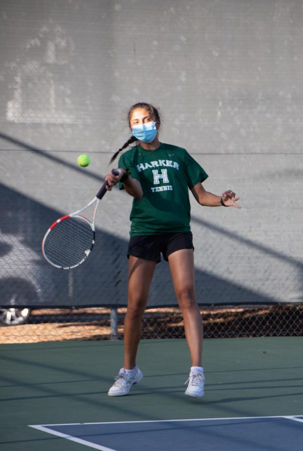 Anishka Raina (12) swings at the tennis ball during the varsity girls tennis teams win over Notre Dame Belmont.
