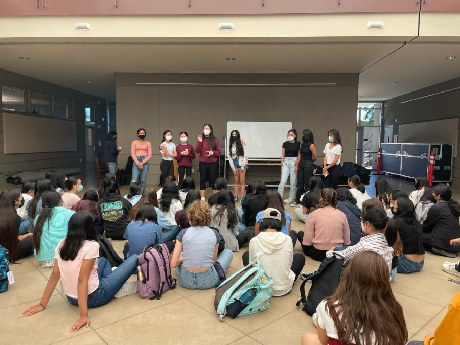 WiSTEM officers Kavita Murthy (12), Claire Luo (10), Ella Yee (10), Emily Zhou (12), Amiya Chokhawala (11), Catherine He (12), Thresia Vazhaeparambil (12) and Eileen Ma (11) hold a club meeting in the Nichols Atrium on Sept. 20. The club aims to encourage more female students to participate in STEM fields.