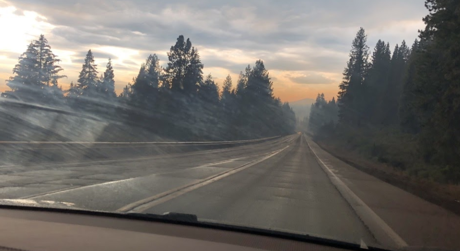 Smoke fills the sky ahead of upper school Spanish teacher and Green Team adviser Diana Moss's car as she is about to drive past the Dixie Fire. The fire has burnt over 963,309 acres.