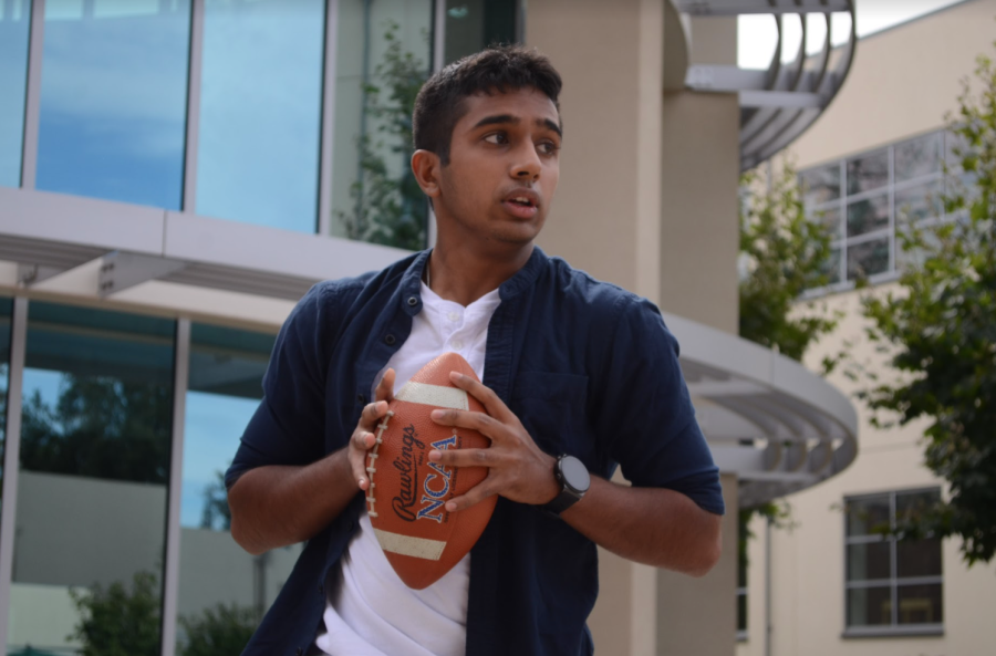 Opinions editor Muthu Panchanatham (12) prepares to throw a football during second period class journalism class. Students practiced their sports photography, capturing Muthus movements while he played.