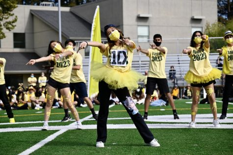 """Eileen Ma (11) dances to One Direction during the junior lip sync. The one-hour event featured lip sync skits from all four classes, performances by the cheer team and Harker Dance Company (HDC), """"Name that Tune"""" with faculty participants and a relay with Homecoming Court representatives."""